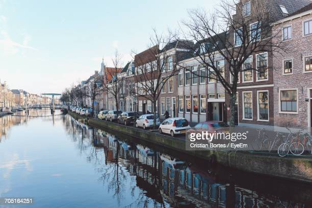 row houses against river in city - bortes stock pictures, royalty-free photos & images