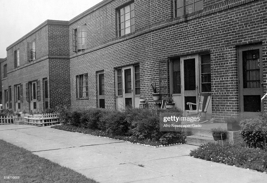 Row houses during the Afro American Newspapers Clean Block urban beautification campaign, Baltimore, Maryland, 1945.