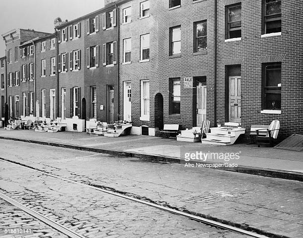 Row houses during the Afro American Newspapers Clean Block urban beautification campaign Baltimore Maryland 1945