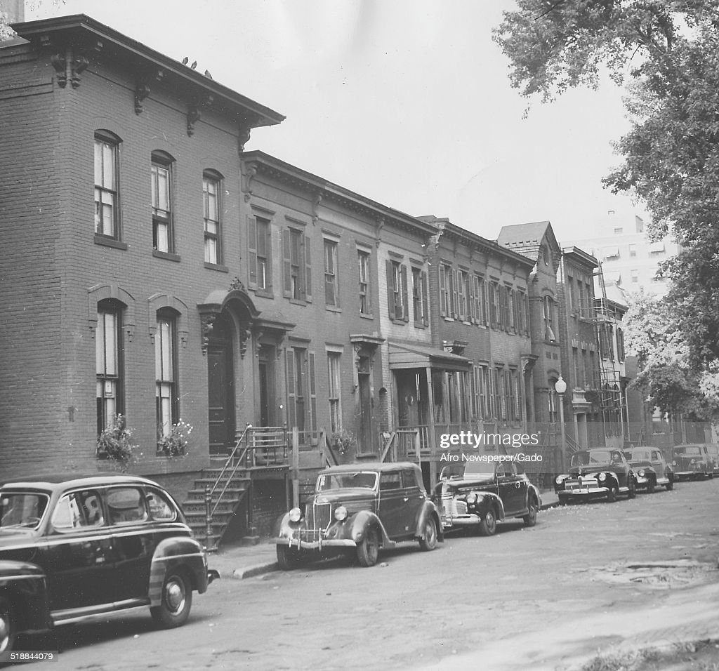 Row houses during the Afro American Newspapers Clean Block urban beautification campaign, Baltimore, Maryland, 1955.