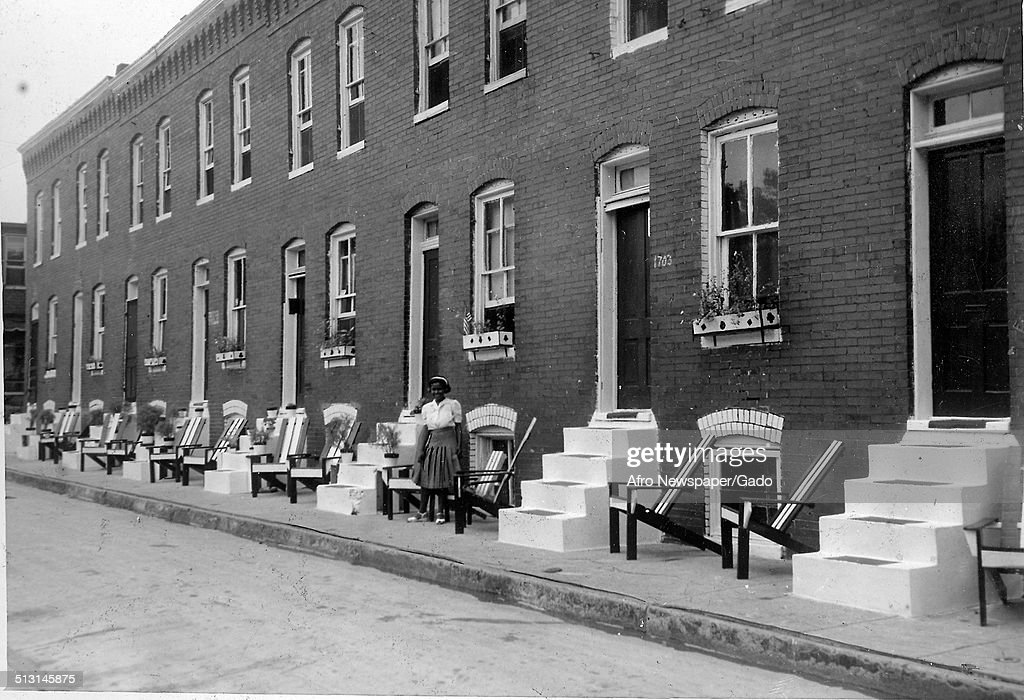 Row houses in a street during the Afro American Newspapers Clean Block campaign, Baltimore, Maryland, 1939.