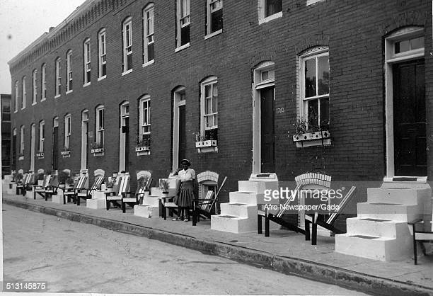 Row houses in a street during the Afro American Newspapers Clean Block campaign Baltimore Maryland 1939