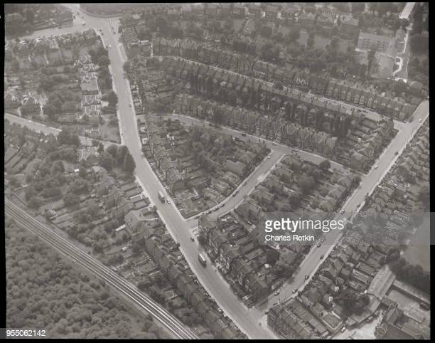 Row houses line curving streets Homes and gardens fill narrow city lots crowded into irregularlyshaped blocks by roads and railroad tracks circa 1950...