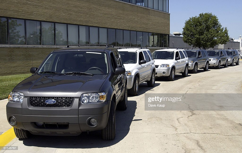 A Row Of 2005 Ford Escape Hybrid Suv S Await Test Drives By Members The