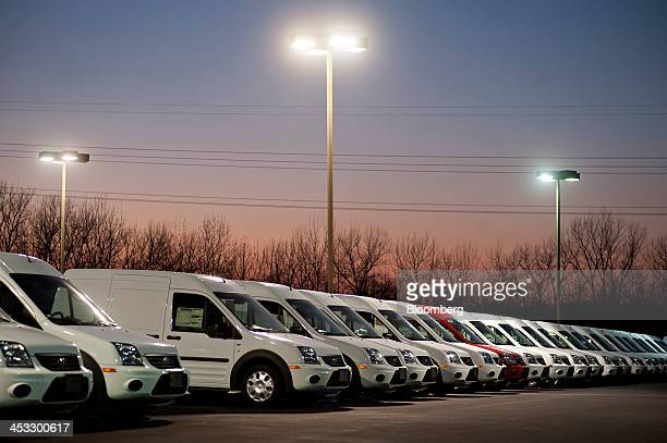 A row of 2013 Ford Motor Co Transit Connect vehicles sit on display at Uftring Ford in East Peoria Illinois US on Saturday Nov 30 2013 Automakers...