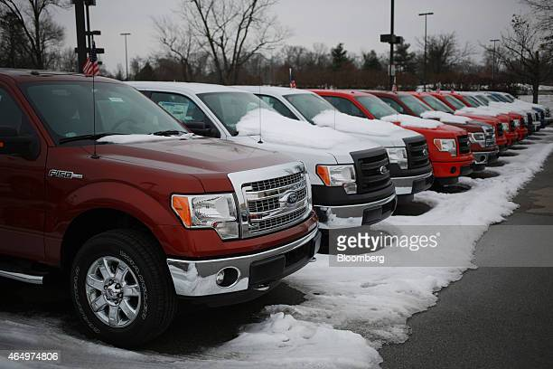 A row of 2015 Ford Motor Co F150 trucks are displayed for sale at the Oxmoor Ford car dealership in Louisville Kentucky US on Wednesday Feb 25 2015...