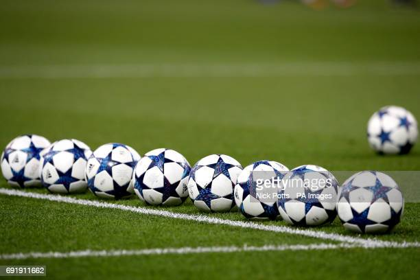 A row of adidas match balls on the pitch before the UEFA Champions League Final at the National Stadium Cardiff