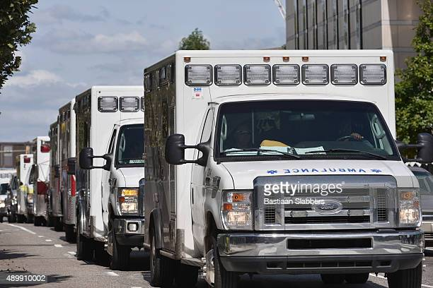 row of ambulances - basslabbers, bastiaan slabbers stock pictures, royalty-free photos & images