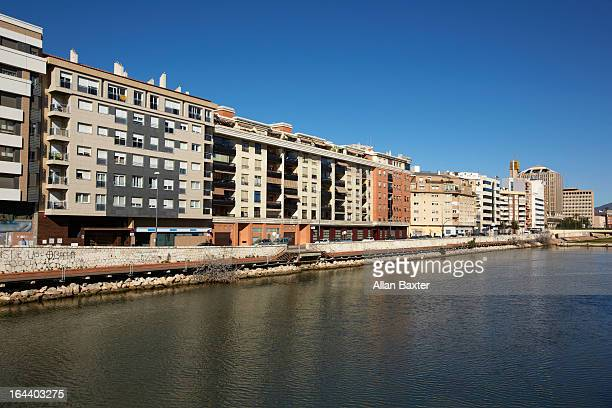 Row of apartments along river