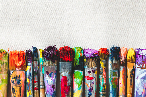 Row of artist paintbrushes closeup on canvas. 514627514