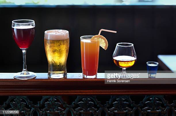 Row of assorted drinks in a bar