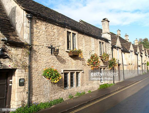 A row of attractive stone cottages in Castle Combe Wiltshire England UK claimed to be Englands prettiest village
