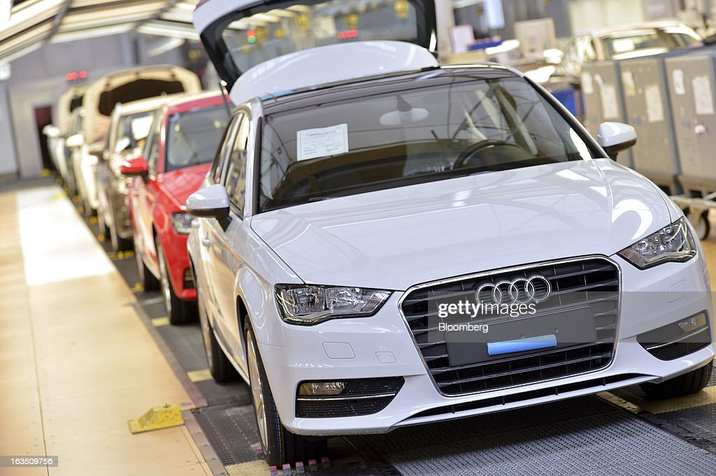 A row of Audi A3 automobiles, produced by Volkswagen AG's Audi brand, wait for their final inspection as they move along the production line at the company's plant in Ingolstadt, Germany, on Monday, March 11, 2013. Audi, the world's second-largest maker of luxury vehicles, plans to spend 13 billion euros ($17 billion) through 2016 to develop new cars and expand production capacity as it pursues Bayerische Motoren Werke AG's sales lead. Photographer: Guenter Schiffmann/Bloomberg via Getty Images