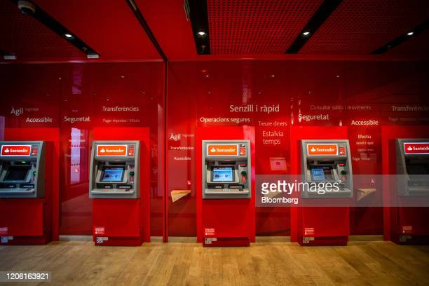 A row of automated teller machines sits inside a Banco Santander SA bank branch in Barcelona Spain on Friday March 6 2020 Spanish bank shares soared...