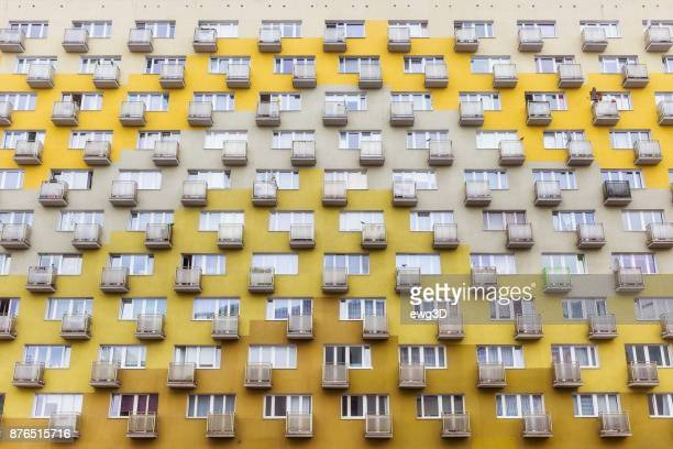 row of balconies in old apartment building - council flat stock pictures, royalty-free photos & images