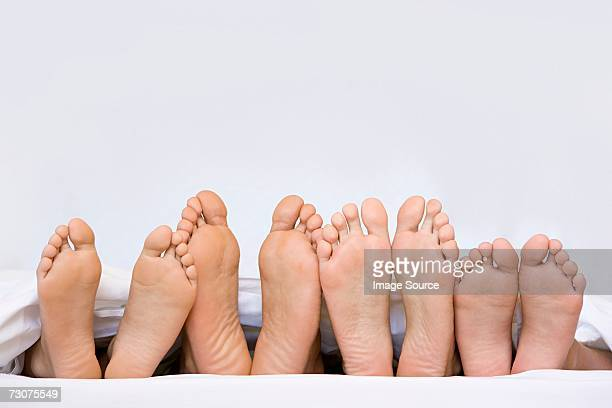 A row of bare feet