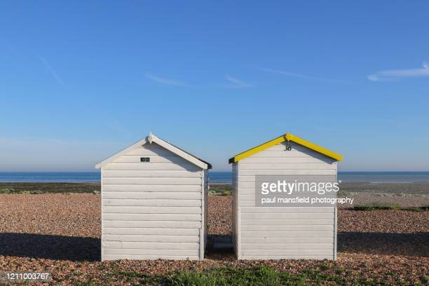 row of beach huts - escaping stock pictures, royalty-free photos & images
