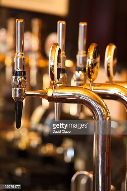 Row of Beer Pumps in Pub, UK