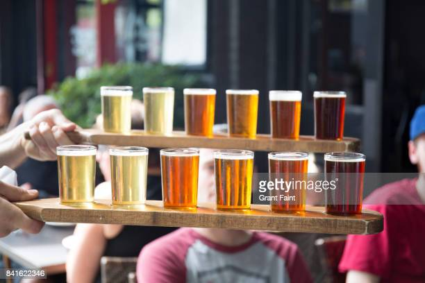 row of beers as sampler. - portland oregon stock pictures, royalty-free photos & images