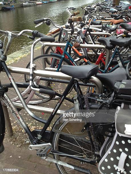 Row of bicycles stretches along a canal in Amsterdam.