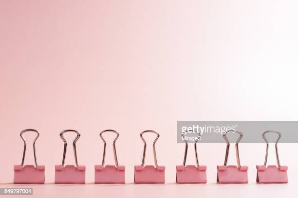 a row of binder clip - neat stock pictures, royalty-free photos & images
