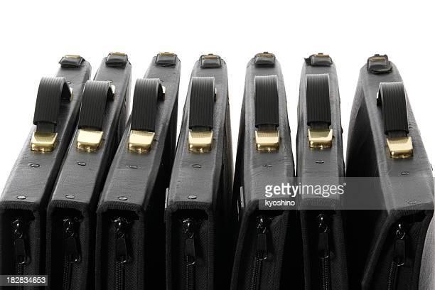 Row of black portfolio against white background