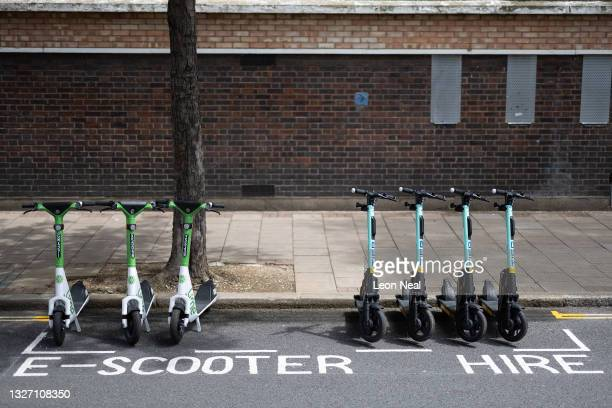 Row of both Lime and Tier electric scooters are seen in a parking bay on July 05, 2021 in London, England. Tier Mobility is one of three e-scooter...