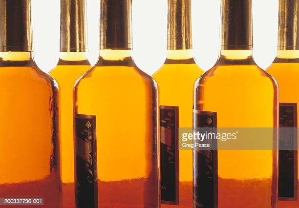 Row of bottles containing bourbon whiskey