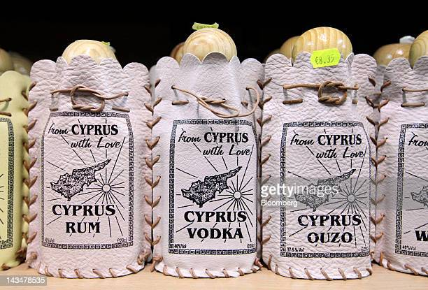 A row of bottles containing Rum Vodka and Ouzo and branded with a map of Cyprus are seen for sale at a tourist store in Limassol Cyprus on Wednesday...