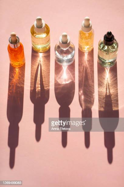 row of bottles with lotions - skin care stock pictures, royalty-free photos & images