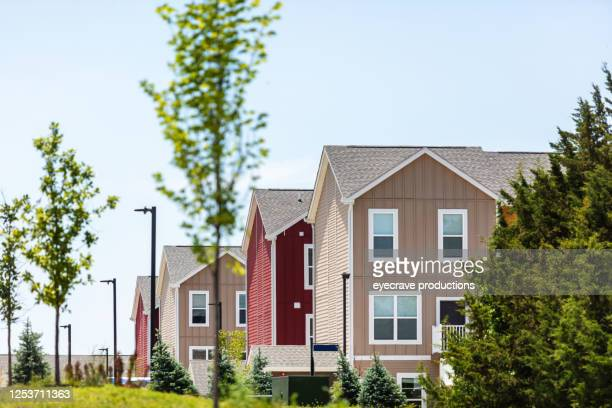 row of bright multi-colored homes on a sunny summer day - kansas city kansas stock pictures, royalty-free photos & images
