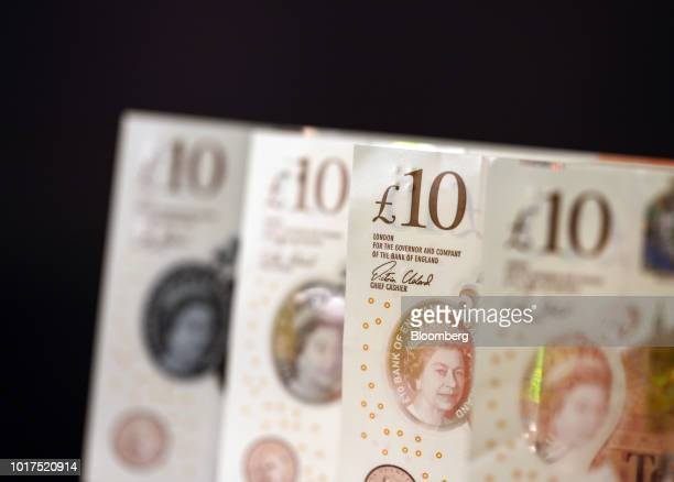 A row of British 10pound banknotes stand in this arranged photograph in London UK on Wednesday Aug 15 2018 The pound's weakness is turning...