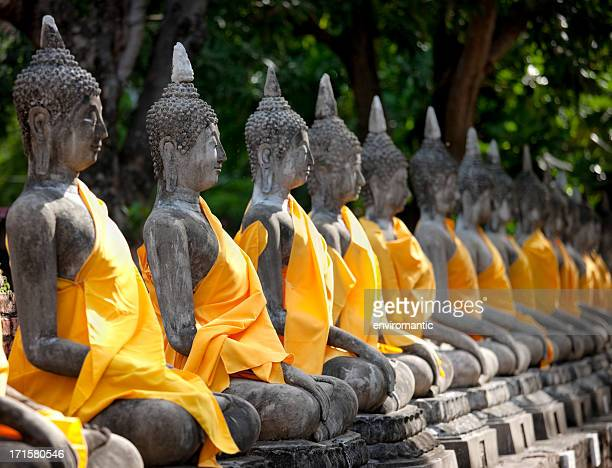 row of buddha images, wat chai mongkon, ayuthaya, thailand. - ayuthaya province stock pictures, royalty-free photos & images