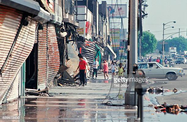 Row of businesses that where burned and looted in South Central Los Angeles. Los Angeles has undergone several days of rioting due to the acquittal...