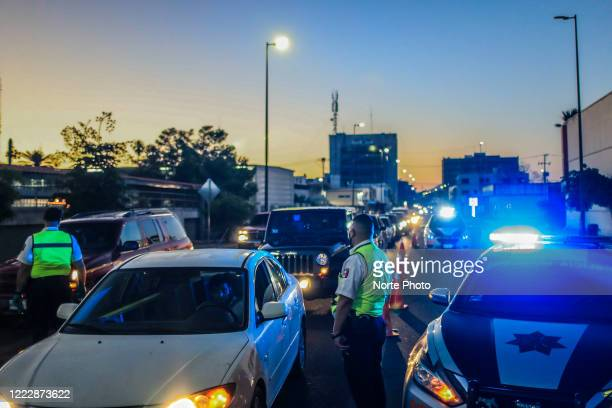 Row of cars at a police road checkpoint during the COVID-19 pandemic on April 25, 2020 in Hermosillo, Mexico. Police installed checkpoints at city...