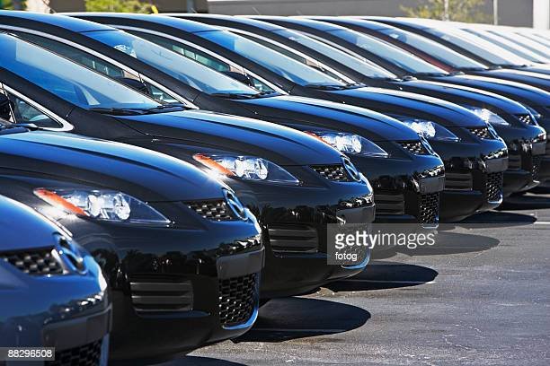 row of cars in car lot - medium group of objects stock pictures, royalty-free photos & images