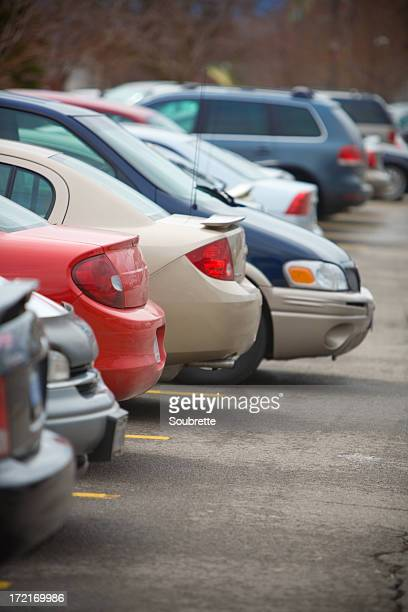 Row of cars parked in a parking lot