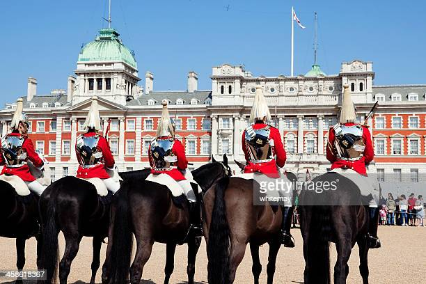 row of cavalrymen at horse guards parade - horse guards parade stock pictures, royalty-free photos & images
