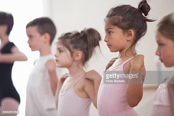Row of children practicing in ballet school