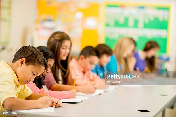 Row of Children Taking an Exam