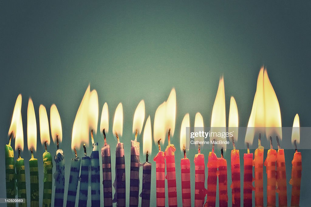 Row of colorful candles : Stock Photo