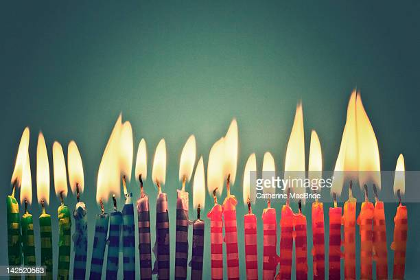 row of colorful candles - catherine macbride stock pictures, royalty-free photos & images