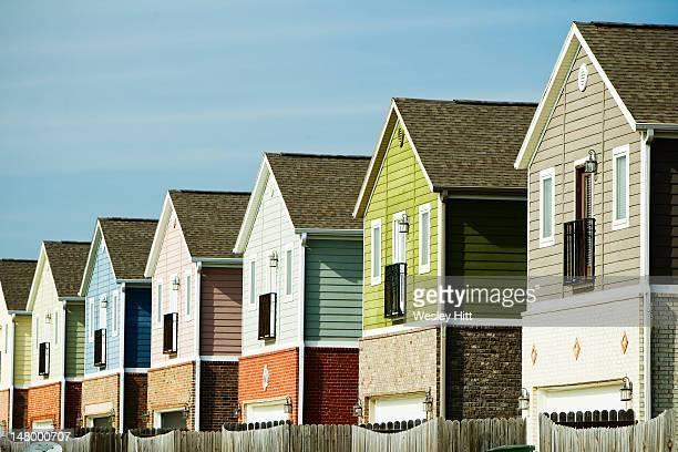 row of colorful homes - ファイアットヴィル ストックフォトと画像