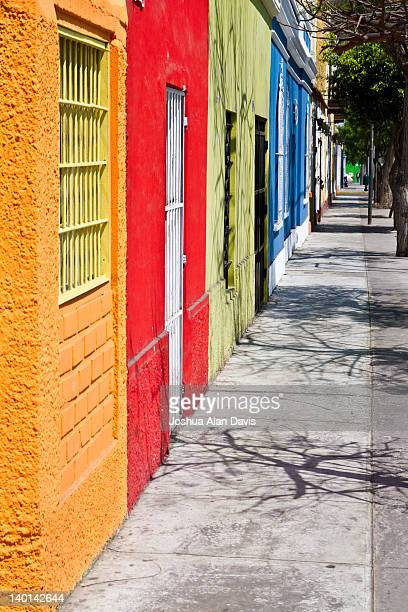 row of colorful houses - joshua alan davis stock pictures, royalty-free photos & images