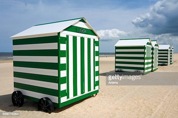 Row of colourful beach cabins on wheels along the North Sea coast at De Panne Belgium