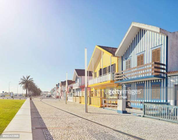 row of colourful beach houses in costa nova, portugal - beach house stock pictures, royalty-free photos & images