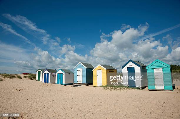 CONTENT] A row of colourful beach huts along the sea front in Southwold Suffolk which is on the eastern North Sea coast of England The foreground...