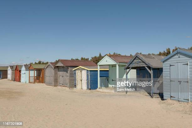 A row of colourful beach huts on the 8th September in West Wittering in the United Kingdom