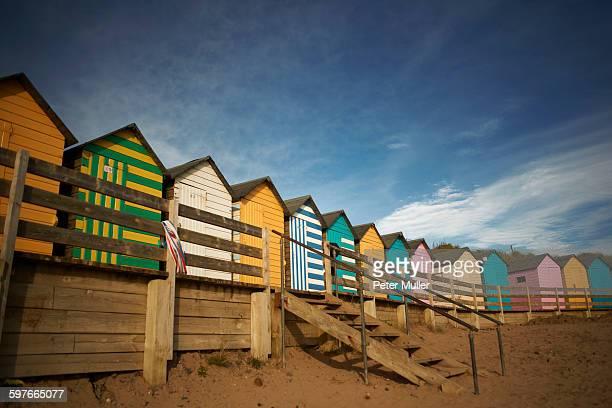 Row of colourful beachhuts, Bude, Cornwall, UK