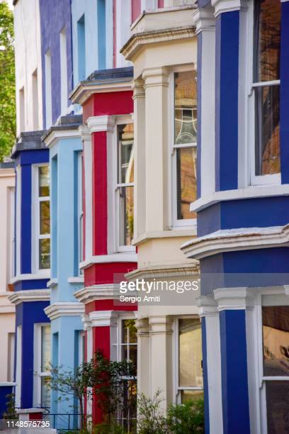 row of colourful houses in notting hill - notting hill stock pictures, royalty-free photos & images